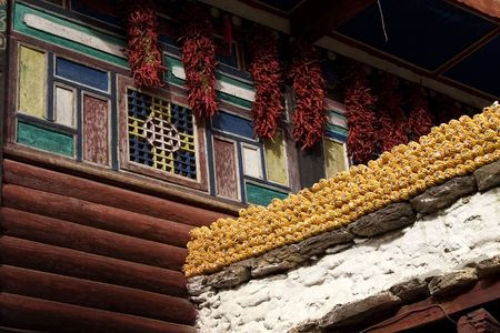 tibetan house in sichuan, corn and pepper on the walls