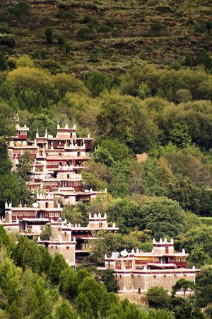 tibetan houses on the mountains of sichuan photo