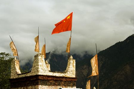 red flag on rooftop in tibet photo