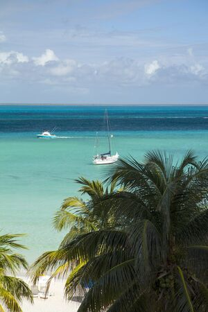 mujeres: paradise in Mexico, boat in pristine blue water, Caribbean holiday