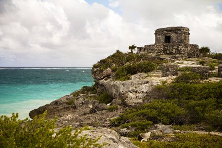 mayan riviera: Mayan temple over the cliff in Tulum, Mexico