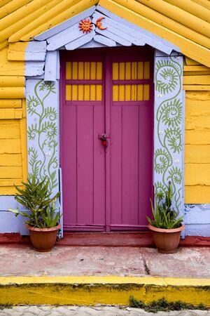 mujeres: colorful door in Mexico