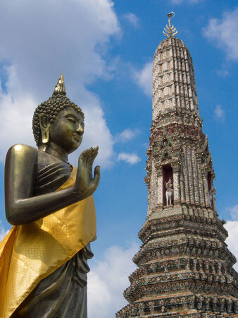 persuading: buddha on the attitude of persuading his relatives not to quarrel int The Temple of Dawn Wat Arun Bangkok, Thailand Stock Photo