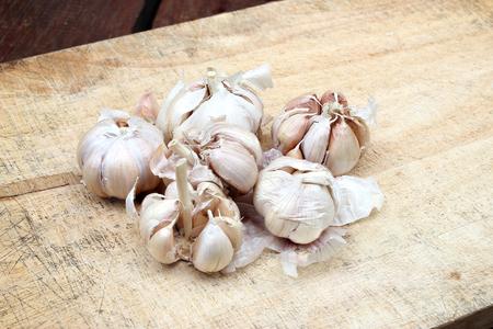 garlic: sliced garlic, garlic clove, garlic bulb on chopping block