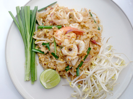 thai style: Thai style noodles. Thailands national dishes, stir-fried rice noodles with shrimp and squid (Pad Thai)
