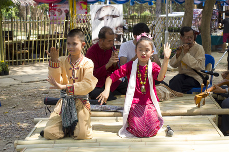 April 10, 2016 : The Boy and The Girl sing a song in lanna style, in the north of thailand at public park (Khelang Nakorn Park) in songkran festival in Lampang, Thailand on April 10 , 2016