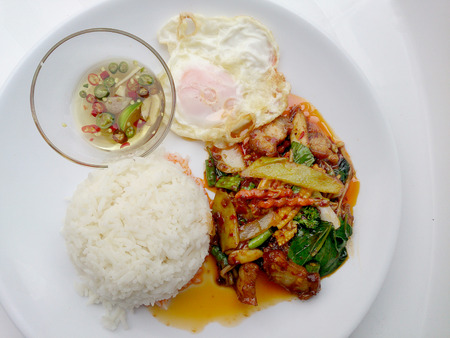 fired egg: Fried crispy pork with Chili sauce and mix vegetable, with rice, fired egg. Thai Food.