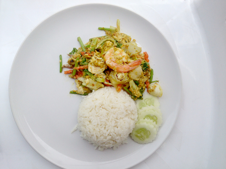 person appetizer: Thai Crab Curry Recipe - The fired curry shrimp and squid, mix seafood with mix vegetable. Phat phong kari in Thai, Thai Food. Stock Photo