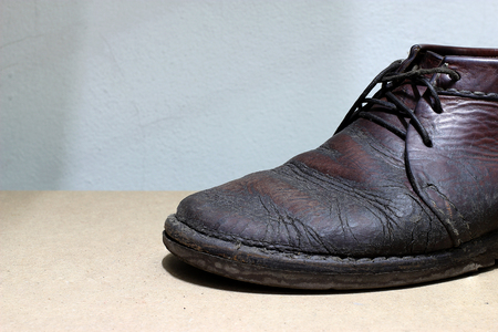 lux: Fashionable mens leather shoes on a dark abstract background. Autumn - spring shoes. brown boots closeup Stock Photo