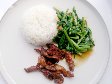 chinese spinach: Stir Fried Water Spinach and Fried pork with rice .food asian Stock Photo