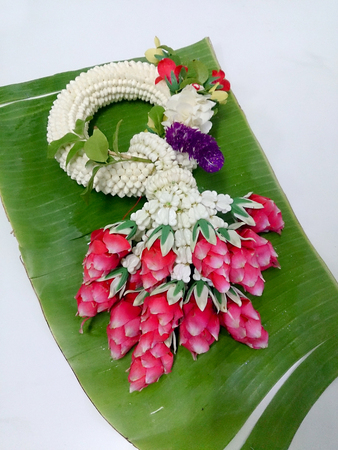 malai: Jasmine garland Thai on banana leaf have unique ways of arranging flowers and using them in decorations, which are different from other places. Thai garlands called Phuang Malai