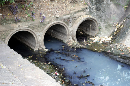 dredging: Toxic water running from sewers in dirty underground sewer for dredging drain tunnel cleaning
