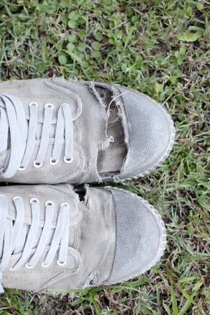 old shoes: Dirty old shoes on grass background