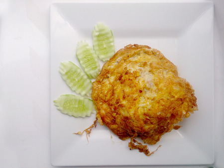 close uo: omelette on the white dish, Its popular traditional Thai style food.