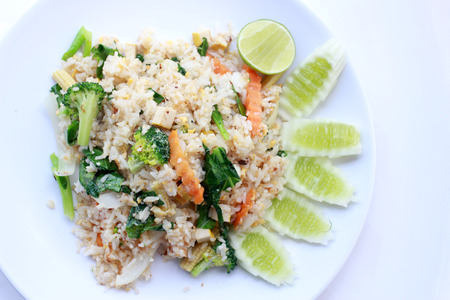 fried rice with vegetable on the white plate with withe background. Vegetarian Food, healthy food, Thai cuisine Stock Photo