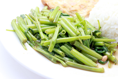 Stir-Fried Chinese Morning Glory, Water Spinach, Tumis Kangkung, stir fried morning glory .phad puk boong fri dang. thai food.