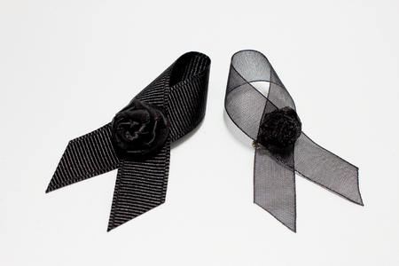 personal ornaments: Black ribbon; decoration black ribbon hand made artistic design for sadness expression isolated on white background.