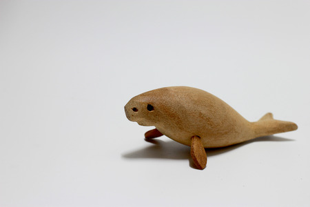 extinct: sculptured wood of the extinct Stellers sea cow isolate on white background.