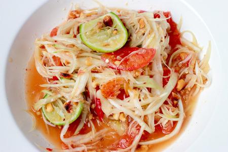 long bean: Green Papaya Salad (Som tum Thai) on table. Thai cuisine spicy delicious.
