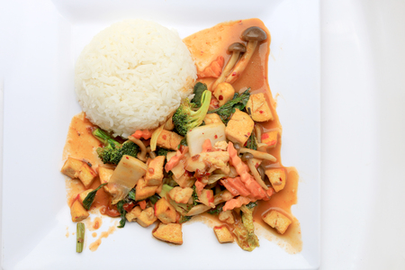 doufu: Stir Fried Tofu with Gravy Sauce and mixed vegetables in white plate on white background. Vegetarian Food, healthy food. Stock Photo