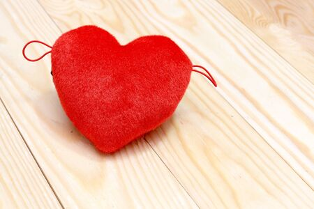 february 1: Valentines day background with red hearts over wood. Top view with copy space