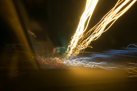 Street lights in speeding car in night time, light motion with slow speed shutter. Stock Photo