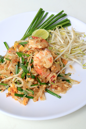 Thai food Pad Thai ,Stir fry noodles with shrimp in white plate. The one of Thailands national main dish. the popular food in Thailand. Thai Fried Noodles.