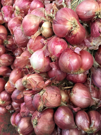 Red onions in plenty on display at local farmers Thailand Market. Big Red Onions Background, Eleutherine bulbosa vegetable thai food.