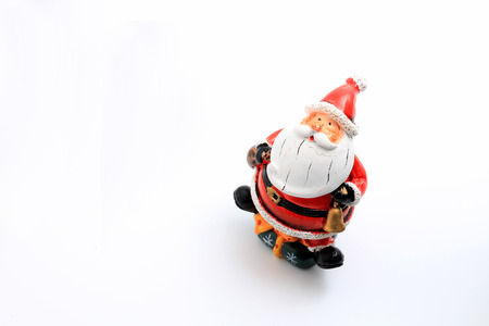 Happy Christmas Santa Claus doll with christmas decorations box isolated on white background with copy space.