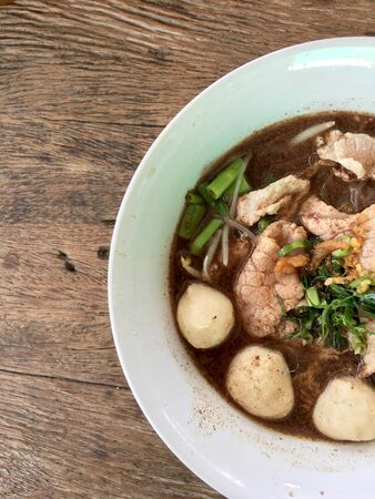 Thai beef noodles braised taste delicious in Thai style on stainless steel table. Very delicious local food with many kinds of ingredients in  thailand, Thai style food.Top view & flat lay Standard-Bild