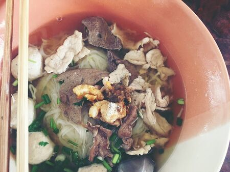Thai beef noodles braised taste delicious in Thai style on stainless steel table. Very delicious local food with many kinds of ingredients in  thailand, Thai style food. Standard-Bild