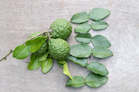 Group of fresh Bergamot fruit and bergamot leaves on wooden table background