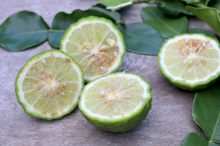 Group of fresh Bergamot fruit and bergamot leaves on wooden table background