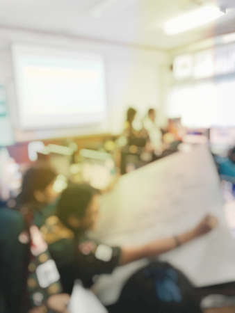 Education concept, blurred image of the student learning technology and workshop using computer together in computer room in secondary, university for study, Network communication, training concept.