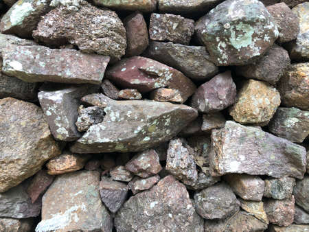abstract background with dry round reeble, pebbles stones wall Standard-Bild - 158042355