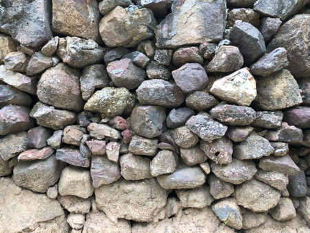abstract background with dry round reeble, pebbles stones wall Standard-Bild - 158042347