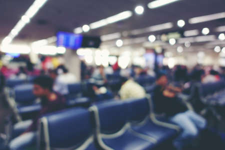 Abstract Blur Background of people or passenger walking in or hurry up in airport transport terminal, Airport Check-In Counters With Many Passengers With Bokeh. vintage tone with light effect.