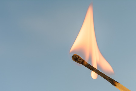 glow stick: Burning match on a blue background