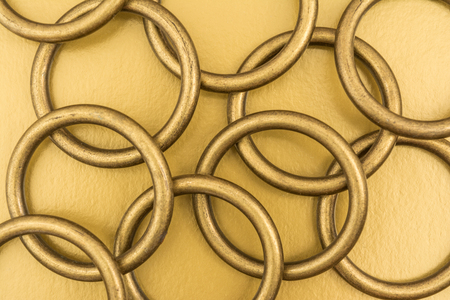 metal grid: Chaotic arrangement of metal rings on a golden background