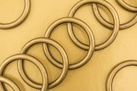 metal grid: Sequential alternation of metal rings on a golden background