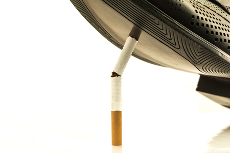 better: No tobacco. The sole of a black boot crushes a cigarette. Repudiation of bad habits