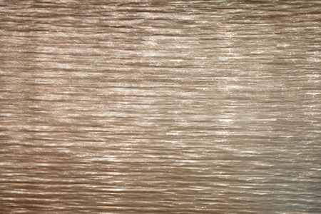 Gray texture shiny metalized relief surface, abstract background Stock Photo