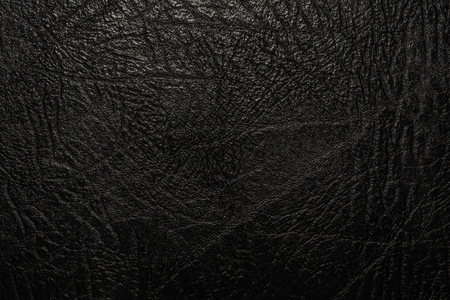black relief texture of artificial leather, close-up abstract background