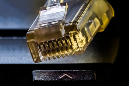 コンピュータネットワーク、マクロ抽象背景への接続のためのプラスチックコネクタRJ 45 写真素材