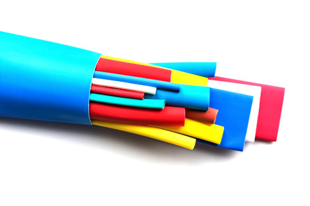 Heat shrink varicoloured tubing components for cables isolation, abstract background