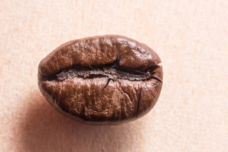 roasted brown natural coffee beans, close-up abstract background Stockfoto