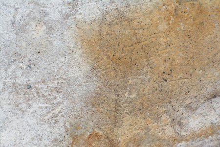 Texture of the surface of an old antique wall with a plaster layer destroyed from moisture, a lot of cracks, irregularities, blisters on the wall, abstract background