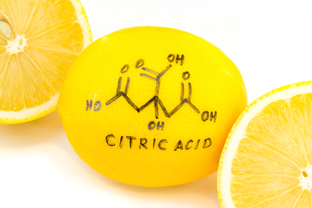 structure of a citric acid molecule painted on lemon peel, abstract background