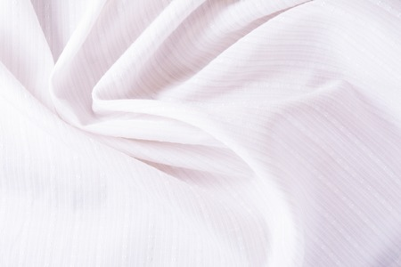 texture of white cotton fabric with arbitrary bends and wave, close-up abstract background Stok Fotoğraf