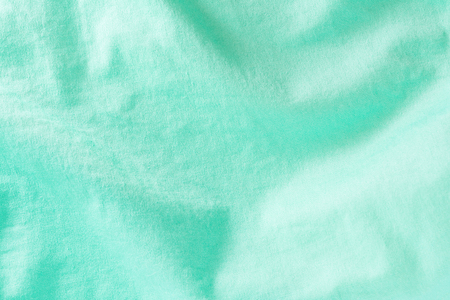 texture of a green cotton fiber surface forming a fabric, close-up abstract background